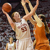 Oklahoma guard Joanna McFarland (53) shoots over the head of Texas forward Anne Marie Hartung (44)  Saturday during the Sooners' game against the Longhorns at the Lloyd Noble Center.<br /> Kyle Phillips/The Transcript