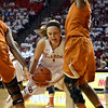 Oklahoma guard Nicole Kornet (1)  tries to get around Texas guard Ashley Roberts (5) to shoot the ball Saturday during the Sooners' game against the Longhorns at the Lloyd Noble Center.<br /> Kyle Phillips/The Transcript