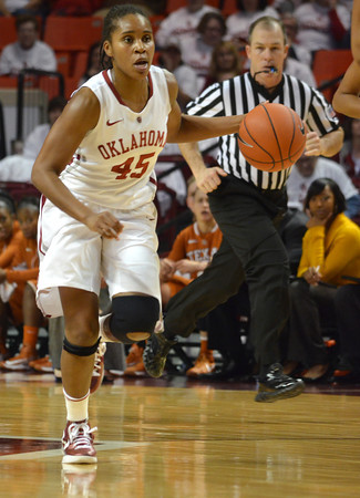 Oklahoma guard Jasmine Hartman (45)  drives down the court Saturday during the Sooners' game against the Longhorns at the Lloyd Noble Center.<br /> Kyle Phillips/The Transcript