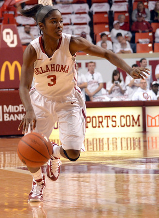 Oklahoma guard Aaryn Ellenberg (3)  drives down the court Saturday during the Sooners' game against the Longhorns at the Lloyd Noble Center.<br /> Kyle Phillips/The Transcript