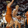 Oklahoma forward Tara Dunn (43) tries to get around  Texas forward Gigi Mazionyte (23) to shoot the ball Saturday during the Sooners' game against the Longhorns at the Lloyd Noble Center.<br /> Kyle Phillips/The Transcript