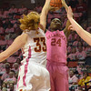 Oklahoma guard Sharene Campbell (24) shoots the ball over Iowa's Chelsea Poppens (33) during the Sooners' game against the Cyclones Thursday at the Llyod Noble Center.<br /> Kyle Phillips/The Transcript