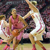 Oklahoma center Nicole Griffin (4) tries to get around Iowa's Anna Prins (55) to take a shot Thursday during the Sooners' game against the Cyclones at the Lloyd Noble Center in Norman, Okla..<br /> Kyle Phillips/The Transcript