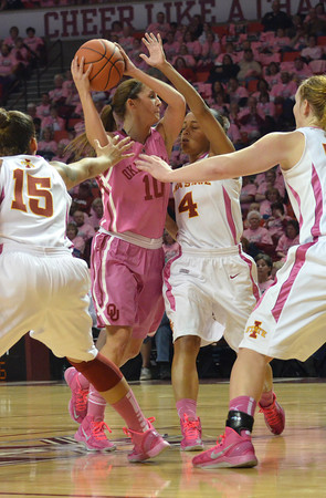 Oklahoma guard Morgan Hook (10) looks for an open teammate as she gets pressured  Iowa during the Sooners' game against the Cyclones Thursday at the Llyod Noble Center.<br /> Kyle Phillips/The Transcript