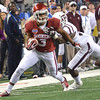 OU's Sterling Shepard gets brought down by a Texas A&M defender Friday during the Sooners' game against the Aggies.<br /> Kyle Phillips/The Transcript