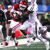 Oklaoma receiver Justin Brown (19) pushes away a Texas A&M defender as he runs with the ball after catching a pass Friday during the Sooners' game against the Aggies.<br /> Kyle Phillips/The Transcript