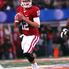 OU quarterback Landry jones looks for an open receiver as he gets ready to pass the ball Friday during the Sooners' game against Texas A&M in Dallas for the Cotton Bowl.<br /> Kyle Phillips/The Transcript