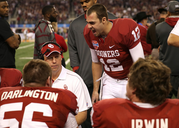 OU quarterback Landry Jones tries to pump up the Oklahoma bench Friday during the Cotton Bowl.<br /> Kyle Phillips/The Transcript