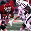 Oklahoma running back Brennan Clay plows through the Aggie defensive line as he runs with the ball during the Cotton Bowl.<br /> Kyle Phillips/The Transcript
