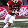 Oklahoma's Brennan Clay (24) runs with the ball during the Sooners game against Texas A&M Friday at Cowboy Stadium during the Cotton Bowl.<br /> Kyle Phillips/The Transcript