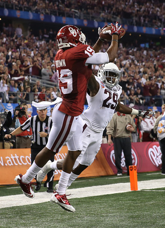 OU reciever Justin Brown makes a catch in the end zone, scoring a touchdown for the Sooners during their game against Texas A&M Friday in Dallas.<br /> Kyle Phillips/The Transcript