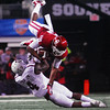 Oklaoma receiver Justin Brown (19) flies over Texas A&M's Toney Hurd (4) as he runs with the ball after catching a pass Friday during the Sooners' game against the Aggies.<br /> Kyle Phillips/The Transcript