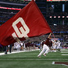 An member of the Ruf/Neks carries the OU flag through the end zone after the Sooners score a touchdown during the Cotton Bowl Friday at Cowboys Stadium in Dallas.<br /> Kyle Phillips/The Transcript
