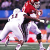 Oklahoma quarterback Blake Bell gets brought down by Tecas A&M's Jonathan Stewert as he runs with the ball during the Sooners' game against the Aggies at Cowboy Stadium in Dallas.<br /> Kyle Phillips/The Transcript