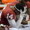 OU's Aaron Calvin hangs his head as the final seconds tick off the clock during the Sooners' game against Texas A&M.<br /> Kyle Phillips/The Transcript