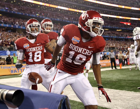 OU reciever Justin Brown celebrates in the end zone after scoring a touchdown for the Sooners during their game against Texas A&M Friday in Dallas.<br /> Kyle Phillips/The Transcript