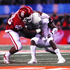 OU's Geneo Grissom brings down a Texas A&M player Friday during the Sooners' game against The Aggies.<br /> Kyle Phillips/The Transcript