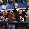 Texas A&M fans celebrate after the Aggies score their first touchdown against Oklahoma at the Cotton Bowl Friday night.<br /> Kyle Phillips/The Transcript