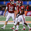 OU quarterback Landry Jones talks to his teammates as they leave the filed after a turnover at the Cotton Bowl.<br /> Kyle Phillips/The Transcript
