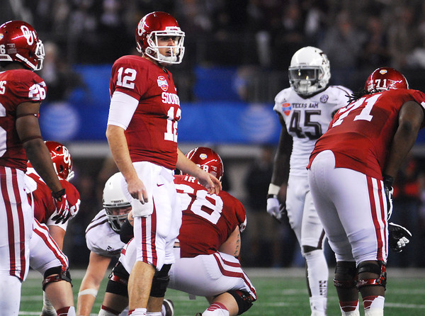 OU quarterback Landry Jones looks to the sidelines for a play change during the Sooners' game agaisnt Texas A&M.<br /> Kyle Phillips/The Transcript