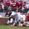 OU running back Damien Williams (26) tries to push his way through Florida A&M defenders as he runs with the ball during the Sooners' game against the Rattlers Saturday at Owen Field.<br /> Kyle Phillips/The Transcript