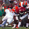 OU running back Brennan Clay (24) tries to push his way through Florida A&M defenders as he runs with the ball during the Sooners' game against the Rattlers Saturday at Owen Field.<br /> Kyle Phillips/The Transcript