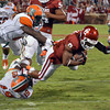 Oklahoma's Dominique Whaley dives, trying to gain a few extra yards as he is tackled during the Sooners' game against Florida A&M Saturday at Owen Field.<br /> Kyle Phillips/The Transcript