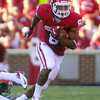 OU running back Dominique Whaley (8) runs down the field after taking a handoff during the Sooners' game against the Rattlers Saturday at Owen Field.<br /> Kyle Phillips/The Transcript