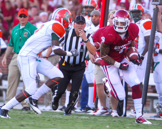 OU wide receiver Kenny Stills (4) looks for an opening to get through a  Florida A&M defender as he runs with the ball after making a catch during the Sooners' game against the Rattlers Saturday at Owen Field.<br /> Kyle Phillips/The Transcript