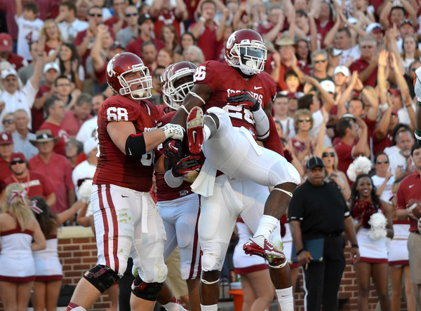 Ou running bac Damien Williams (26) celebrates with teammates after scoring a touchdown in the first quarter  during the Sooners' game against the Rattlers Saturday at Owen Field.<br /> Kyle Phillips/The Transcript