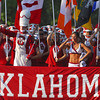 The OU marching band heads toward Owen Field as they parade down Jenkins Ave. Saturday before the Sooners' game against Kansas State.<br /> Kyle Phillips/The Transcript