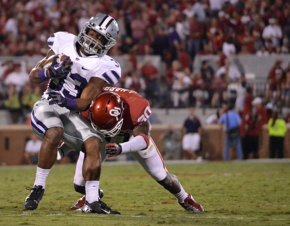 Ou's Javon Harris (30) tackles Kansas State's John Hubert (33) Saturday during the Sooners' game against the Wildcats at Owen Field.<br /> Kyle Phillips/The Transcript