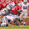 OU running back Dominique Whaley (8) is brought down by the Kansas State defense as he runs with the ball Saturday during the Sooners' game against the Wildcats at Owen Field.<br /> Kyle Phillips/The Transcript