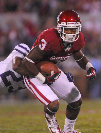 Oklahoma wide receiver Sterling Shepard (3) tries to slip past Kansas State defender Jarard Milo (23) after he catches a pass close to the end zone Saturday during the Sooners' game against the Wildcats at Owen Field.<br /> Kyle Phillips/The Transcript