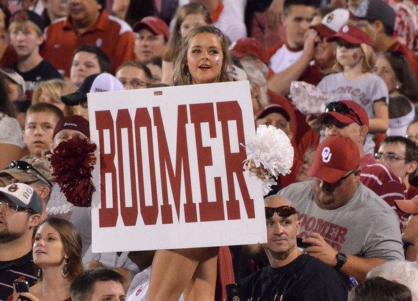 An OU cheerleader tries to get the crowd on its feet as the Sooners approach the end zone Saturday at Owen Field.<br /> Kyle Phillips/The Transcript