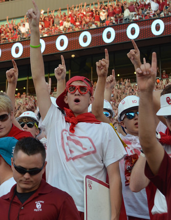 Ou fans cheer on their team from the stands Saturday as the Sooners take on Kansas State at Owen Field.<br /> Kyle Phillips/The Transcript