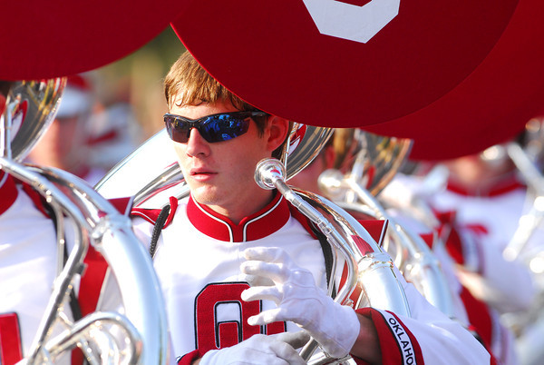 A member of the OU Marching Band prepares to play his instrument as the band makes its way to Owen Field Saturday afternoon.<br /> Kyle Phillips/The Transcript