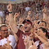 Oklahoma fans cheer as the Sooners prepare for kickoff Saturday during their game against Kansas State at Owen Field.<br /> Kyle Phillips/The Transcript