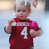 Young Sooner fan Blythe Woodson, 2, shows off her OU pride before the Sooners' game against Kansas State Saturday.<br /> Kyle Phillips/The Transcript