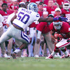 OU V K-State1<br /> Oklahoma receiver Keny Stills (4) tries to slip past Kansas State's Tre Walker (50) Saturday during the Sooners' game against the Wildcats at Owen Field.<br /> Kyle Phillips/The Transcript