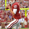 OU quarterback Landry Jones (12) looks for an open receiver saturday during the Sooners' game against Kansas State at Owen Field.<br /> Kyle Phillips/The Transcript