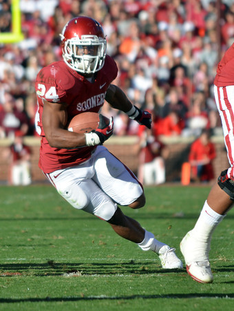 OU running back Brennan Clay (24) runs with the ball Saturday during the Sooners' game against the Cowboys at Owen Field.<br /> Kyle Phillips/The Transcript