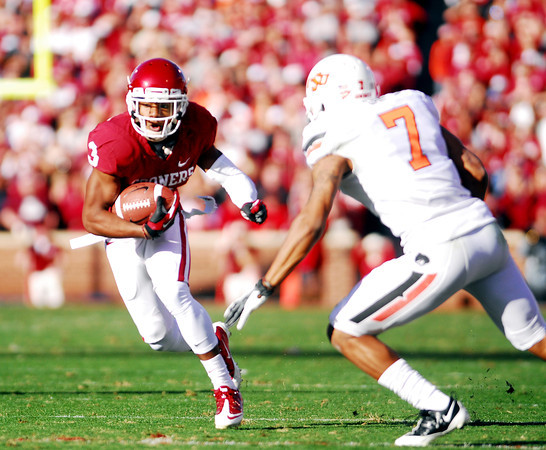 OU running back Sterling Shepard (3) tries to get around OSU's Sahmiel Grey (7)  Saturday during the Sooners' game against the Cowboys at Owen Field.<br /> Kyle Phillips/The Transcript