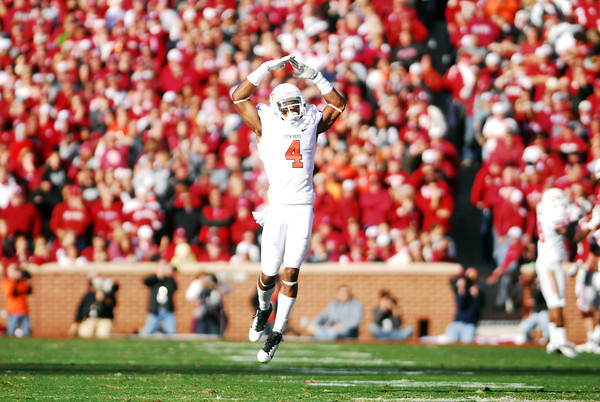OSU's Justin Gilbert (4) celebrates after the Cowboys score a touchdown  Saturday during the Cowboys' game against the Sooners at Owen Field.<br /> Kyle Phillips/The Transcript