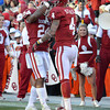 OU's Brennan Clay (24) and Kenny Stills (4) celebrate after the Sooners score a touchdown against OSU Saturday at Owen Field.<br /> Kyle Phillips/The Transcript