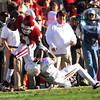 OU receiver Jalen Saunders (18) pushes away an OSU player as he runs with the ball Saturday during the Sooners' game against the Cowboys at Owen Field.<br /> Kyle Phillips/The Transcript