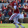 OU quarterback Landry Jones (12) loos for an open receiver  Saturday during the Sooners' game against the Cowboys at Owen Field.<br /> Kyle Phillips/The Transcript