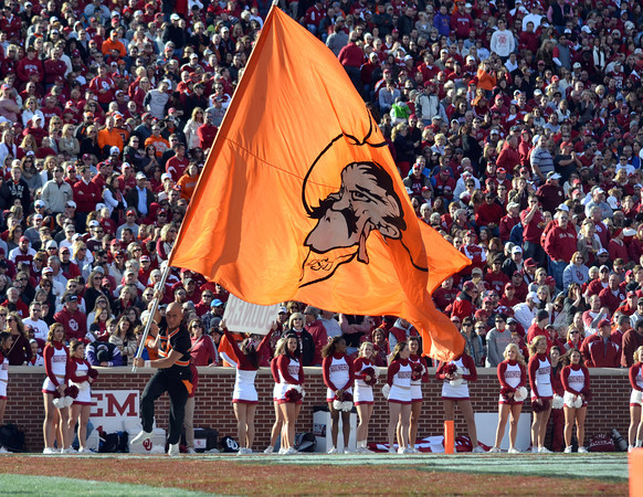 The OSU flag is carried around the end zone after the Cowboys score a touchdown Saturday during the Sooners' game against the Cowboys at Owen Field.<br /> Kyle Phillips/The Transcript