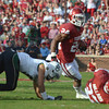 OU running back Brennan Clay runs around the end  Saturday during the Sooners' game against the Bears at Owen Field.  Clay scored on the play.<br /> Kyle Phillips/The Transcript