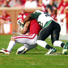Oklahoma's Kenny Stills (4) gets tackled by a Baylor player Saturday during the Sooners' game against the Bears at Owen Field.<br /> Kyle Phillips/The Transcript